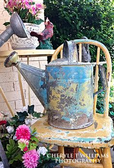 Gorgeous Aqua & Yellow Shabby Watering Can & Child's Chair. It doesn't get any better than this! Old Town Village Antiques & Uniques in Waxahachie TX.