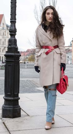 Fashion Blogger Veronika Lipar of Brunette from Wall Street wearing distressed blue Levi's jeans, off-white double breasted Weekend Maxmara coat, red dangling belt, blush Gianvito Rossi plexi pumps, See by Chloe pink top handle bag, blue leather gloves walking down the street in Ljubljana