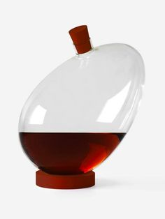 Egg decanter by Sebastian Bergne, manufactured by Designerbox. A playful spirit decanter with a symbolic egg form. Standing on it's ring it will take up any position, ready to be called into action. Cardboard Packaging, Form Design, Decanter, Cork, Whiskey, Food And Drink, Eggs, Spirit, Action