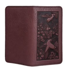 Leather checkbook cover handmade by Oberon Design in the U.S.A. Unique imagery, premium leather, size fits standard sized American checks. - SPECS - FAQ Our handmade products take 3 - 5 days to bench craft. Find out more about order processing and shipping times. Specs: Colors: Red, Wine Dimensions: 3.5 x 6.5 inches, folded. Description: - Fits carbon or non-carbon standard sized checks - Two pockets & and carbon protector flap - Bench crafted in several of our most popular designs…