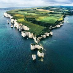 """dailyoverview: """" Check out this incredible shot of the Old Harry Rocks in Dorset, England from @awesome_naturepix. These rock formations consist of chalk stalks were formed approximately 66 million..."""