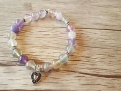 Items similar to Gorgeous Symbolic Bracelet- 'Over-The-Rainbow' with Rainbow fluorite beads, Pewter beads and a Pewter heart charm on Etsy My Etsy Shop, Beaded Bracelets, Symbols, Trending Outfits, My Love, Unique Jewelry, Handmade Gifts, Check, Shopping