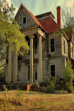 Abandoned mansion with columns
