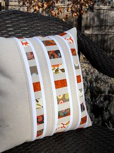 I like this elegant pieced pillow.  Looks simple to piece, too.