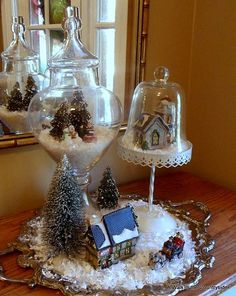 Christmas Village on a Silver Platter — clever uses of various glass cloches.