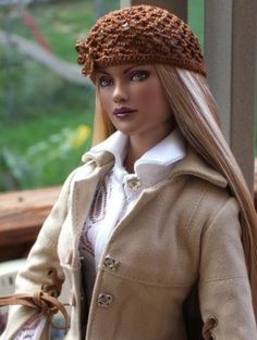 About Repainted Glinda: My first repainted doll wearing a crocheted hat I made.