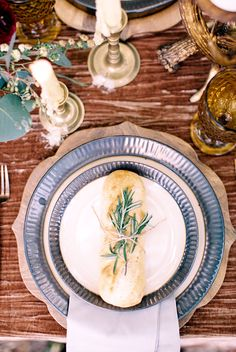 place settings with bread - photo by Laura Ann Miller Photography http://ruffledblog.com/royalty-inspired-wedding-ideas-at-a-castle
