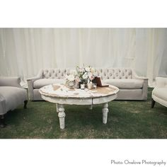 Balboa White Coffee Table at Found Vintage Rentals. White round coffee table with chippy paint and weathered patina