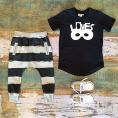 BOYS • Beau LOves tee (on sale), Minti charcoal stripe trackies & Converse low rise Chuck Taylors. All available at Tiny Style in Noosa & online •    www.tinystyle.com.au