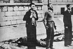 Three Jewish resistance members about to be executed during the Warsaw Ghetto uprising in 1944.  The range of emotions is obvious;  one in mortal fear and pleading, one erect and defiant, and one resigned and relaxed.  During the uprising, the Jews managed to hold off the Nazis for a while, killing many and wounding more before being overrun and burned out of hiding.