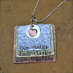 Live, Laugh, Love - Family Metal Stamped Necklace. $30.00, via Etsy.