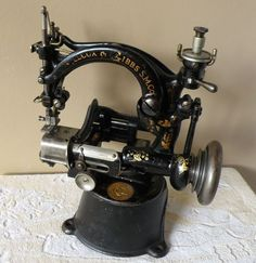 Cast iron Willcox and Gibbs antique machine.