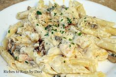 Creamy Alfredo Pasta with Shrimp, Mushrooms and Sun Dried Tomatoes