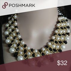 Black white glass pearl bib necklace This is a beautiful handmade necklace made with white glass pearls and black crystals. It has a adjustable clasp so you can adjust around your neck. Pamela May Collection Jewelry Necklaces