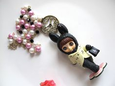 Lolita Style Alice Wonderland Inspired Big Eyed Doll Blythe Melody Musical Black Bunny Big Clock Pearls Swarovski Beaded Necklace. $45.00, via Etsy.