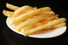 Perfect Thin and Crispy French Fries, boiled with a bit of vinegar, dried, and then twice fried.  Really good, and apparently even better if you freeze them before the last fry. So since frozen is better, have resorted to buying McCain's skinny fries instead, as they are also blanched with acid. So good.