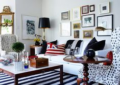Tommy Smythe Portfolio: Electic Living Room: Dalmation Spotted Printed Chairs + White sofa + Stripe Rug + Gallery Wall + flag pillow