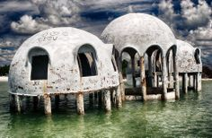 "Abandoned Florida ""Dome Home"" marching into the sea. Once a dream home for one Florida couple, it is now being slowly swallowed by the ocean."