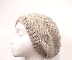 A beanie hat in a light tan color with tiny flecks of dark brown and light brown worked into the yarn. Great beanie for men or women. Very stretchy, will fit any head, will stretch out to 31 inches around. Available at:  http://www.CaboDesigns.etsy.com
