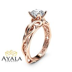 moissanite engagement ring set in rose gold swirl pattern band