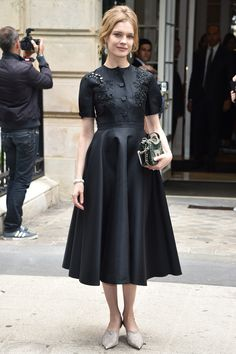 4 July Natalia Vodianova wore a pretty black midi-dress for the show. - HarpersBAZAAR.co.uk