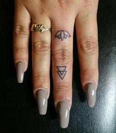 Lotus Flower Finger Tattoo.