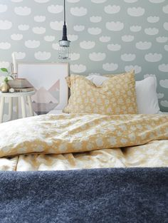 Love the patterns of the wall and bed linen. Plus the giant wall art by the bedside!