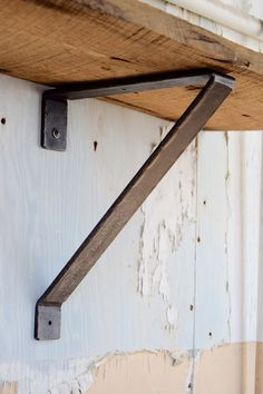 "Hand-hammered metal shelf bracket with blackened iron finish. Heavy-duty industrial look and feel. This shelf bracket measures 11"" x 9"" x 1 1/2""."