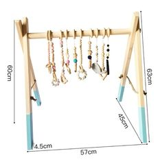 Apart from being a great nursery decor, our wooden baby activity gym is perfect for the development of hand-eye coordination and motor skills. The baby gym is best suited for children younger than 7 months. The baby gym is made… Wood Baby Gym, Diy Baby Gym, Handgemachtes Baby, Baby Play, Baby Activity Gym, Diy Bebe, Play Gym, Ideias Diy, Infant Activities