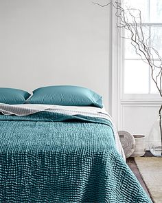 Luminous sand-washed silk is quilted into hand-stitched waves of ... : silk quilt bedding - Adamdwight.com