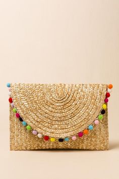 See more detail about Rainbow Pom Pom Straw Clutch..