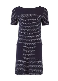 A comfortable and stylish pick for Spring and Summer, the Faye Pocket Dress has a relaxed fit and short sleeves. The dress features a playful ribbon print with contrast plain front pockets. Pair with leggings and a hand knitted cardigan in cool weather.