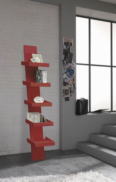 Bellissima libreria dal design moderno e forme uniche, adattabile a qualsiasi tipo di ambiente...