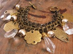 Upcycled Jewelry - Vintage Chic Chunky Pearl, Chandelier Crystal and Brass Dog License Tag Multi-Strand Bracelet - New York, Michigan by thekeyofa on Etsy https://www.etsy.com/listing/213124555/upcycled-jewelry-vintage-chic-chunky