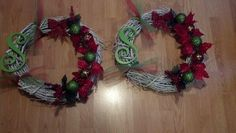 Christmas wreaths. Grapevine wreaths spray painted white and decorated with wooden letter and misc. ornaments and Christmas floral pieces.