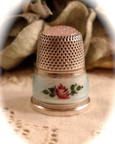 VINTAGE SEWING THIMBLE Sterling Silver Floral Guilloche Enamel Pink Glass Topped Thimble. via Etsy.