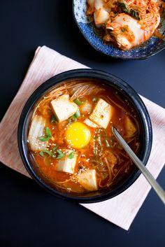 Korean Gojuchang Tofu Soup with Kimchi, Enoki Mushrooms, Egg, Sesame Seeds and Soy Sauce