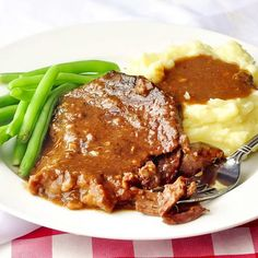 Stewed Steak - Stewed Steak - an easy method for slowly braising lean steak cuts into falling apart, tender beef which forms it's own rich gravy. This is one of our family's very favorite comfort food meals.