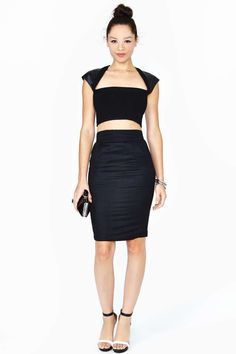 Fendi black pencil skirt featuring pockets at front and a button/zip closure at back. Small slit at back hem with button detailing, unlined.