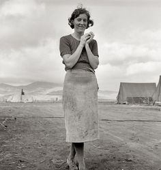 Dorothea Lange | Hole in the Clouds    Dorothea Lange photographed this woman in a migrant farmworker camp in Klamath County, Oregon, in 1939. According to Lange's notes, the woman was a young mother, originally from El Paso, Texas, who had just finished her washing.