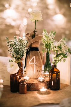 wine bottle and burlap table numbers and rustic wedding decor | One Fab Day