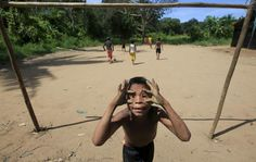 A Colombian Nukak Maku Indian boy gestures in a refugee camp at Agua Bonita near San Jose del Guaviare of Guaviare province September 3, 2015. Since emerging from the jungle in 2005, half naked and carrying blowpipes, the Nukak have lived in settlements near the frontier town of San Jose del Guaviare, a humid outpost in the Amazon 400 km (250 miles) southeast of the capital Bogota. REUTERS/John Vizcaino
