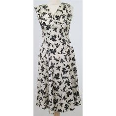Lovely dress from Sambo Fashions in cream slubbed fabric with a black floral design in flocked velvet.(Sambo was the brand name for Samuel Sherman who later designed for the Dollyrockers label). The dress which has the feel of silk, has a V-neckline which crosses