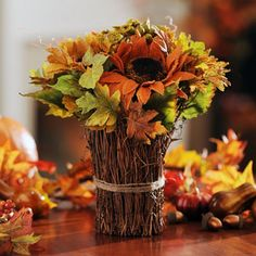I like the idea of bundling twigs with twine or raffia around a vase to create a base for beautiful fall arrangement!