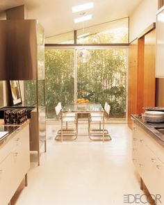 25 Wonderful Kitchen Design Ideas | DigsDigs  Glass table with metal legs
