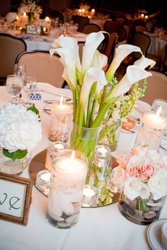 Calla lilies Centerpiece with candles (could work with some mehndi candles surrounding)