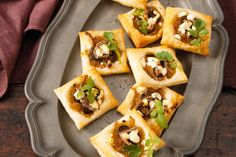 Goat's cheese pissaladiere tarts! Bring warmth and merriment to your next dinner party with these cheerful bites.