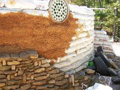 Paul and Lisa Majors earthbag dome home in Arkansas. Good example of the layers. Using stone to hold heat?