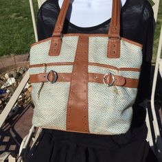 """Stone Mountain Hand Bag NEW without tags. Clean thru and thru!  Beautiful design with colors of cognac & light blue. Lots of storage space with teal/dark blue liner. Exterior...two deep pouches plus a zipper pocket. Interior...3 pouches, center divided with zipper pocket plus a side wall pocket. 10"""" handle drop. Stone Mountain Bags Shoulder Bags"""