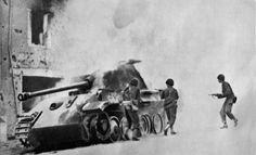 American soldiers control a German Panther tank on fire near the Utah beach
